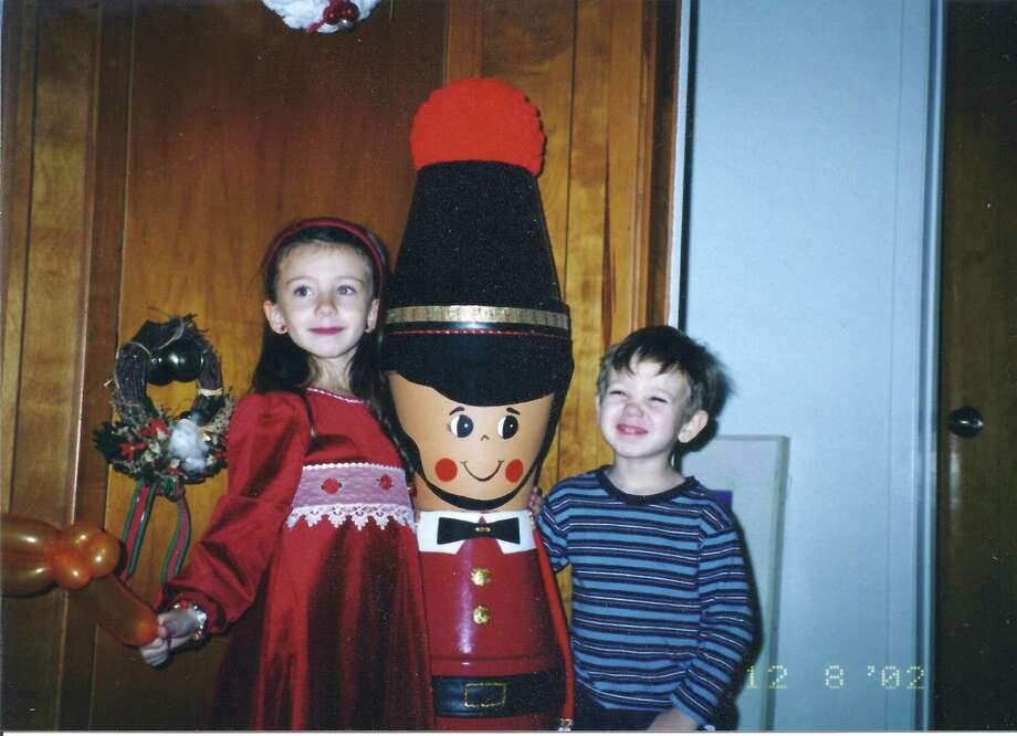 Then: Picture taken December, 2002, at our home in San Antonio. At the time, Nigel, our flower pot Toy Soldier towers over Grandchildren Elisa, 5, and Joaquin, 3. Photo: Picasa, Courtesy Photo