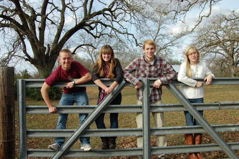 "Now:13 years later, on the same gate, when we were visiting the grandparents again, for Christmas 2012. The ""kids"" are now a sophomore in college, senior in high school, freshman in college, and junior in high school. Photo: Courtesy Photo"