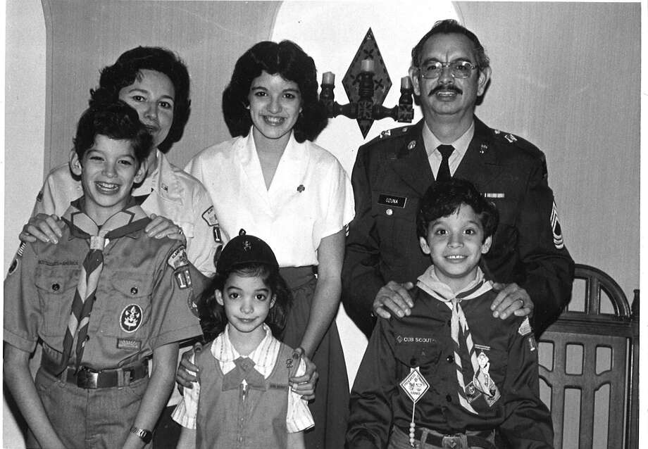Then:The Ozuna family took Scouting very seriously in 1981, when this photo was taken at their first home. Parents Sylvia (top left) and Ted (top right) volunteered as leaders for their church's Den Packs, so that children Leticia (top middle), Andrew (bottom left), Ramona (bottom middle) and Patrick (bottom left) could excel at this civic-minded and enriching activity. Andrew went on to earn the Star rank, Leticia won the First Class award, and Patrick became an Eagle Scout. Photo: Courtesy Photo
