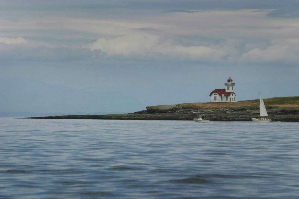The Patos Island Lighthouse is shown as a sailboat and a sporting boat pass the tip of Patos Island. On Monday President Barack Obama will create a 955-acre national monument in the scenic San Juan Islands. We figured it was a time to show some photos from our state's treasure.