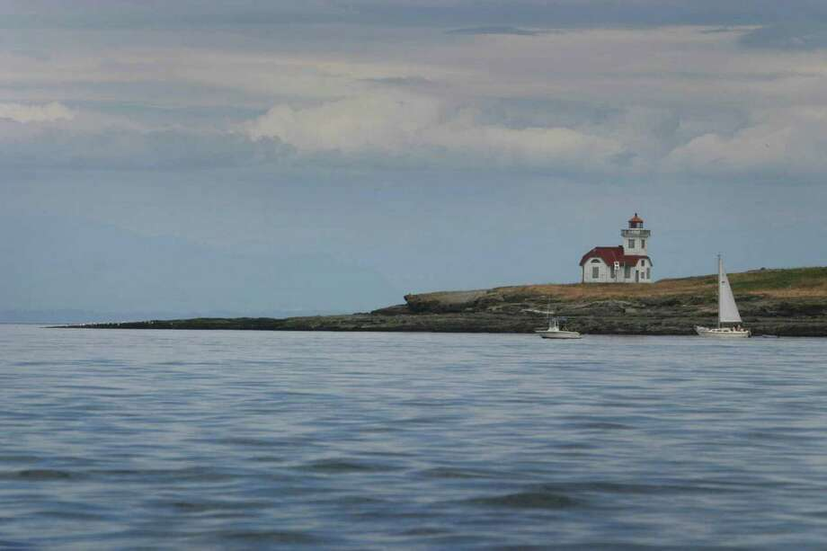 The Patos Island Lighthouse is shown as a sailboat and a sporting boat pass the tip of Patos Island. On Monday President Barack Obama will create a 955-acre national monument in the scenic San Juan Islands. We figured it was a time to show some photos from our state's treasure. Photo: JOSHUA TRUJILLO / SEATTLEPI.COM