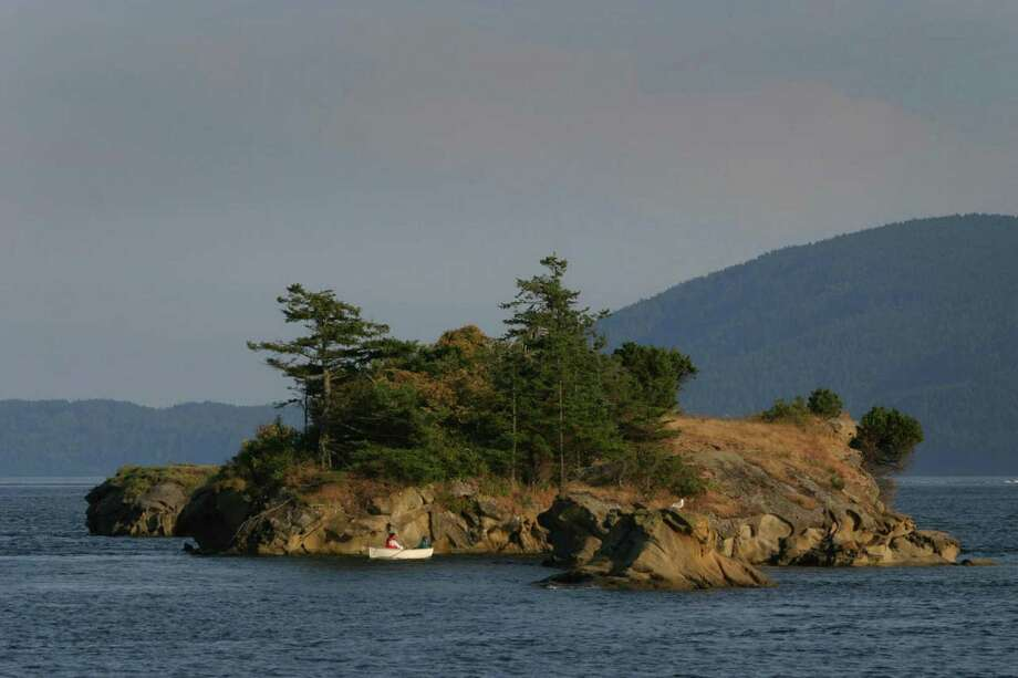 A small island is shown in a remote area of the most northern San edge of the San Juans. On Monday President Barack Obama will create a 955-acre national monument in the scenic San Juan Islands.  Photo: JOSHUA TRUJILLO / SEATTLEPI.COM