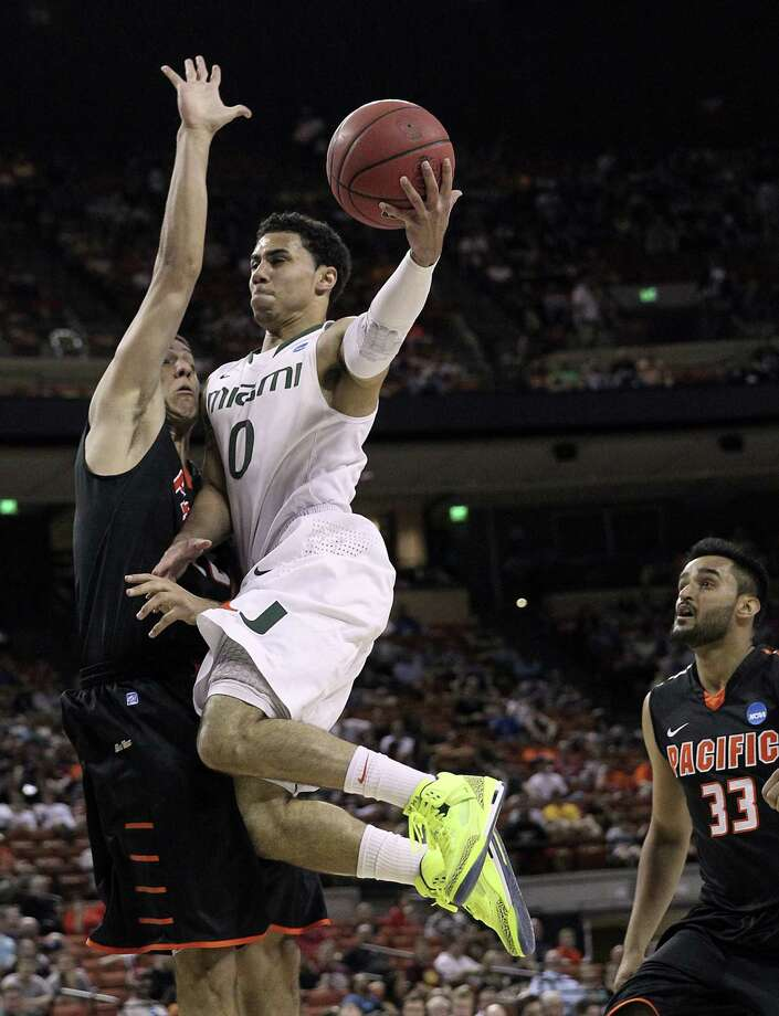 Miami 78, Pacific 49Shane Larkin drives to the hoop during the Hurricanes' win at the Frank Erwin Center in Austin. Photo: Charles Trainor Jr., McClatchy-Tribune News Service / Miami Herald