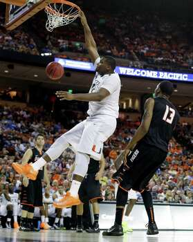 Miami's Reggie Johnson dunks over Pacific's Khalil Kelley (13) during the second half of a second-round game of the NCAA college basketball tournament Friday, March 22, 2013, in Austin, Texas. Miami beat Pacific 78-49. (AP Photo/Eric Gay) Photo: Eric Gay, Associated Press / AP