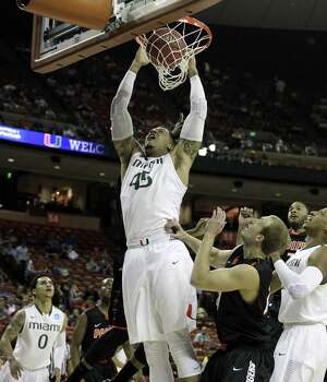 The Miami Hurricanes' Julian Gamble scores the Canes' first basket against Pacific in the first half of a second-round game in the NCAA Men's Basketball Tournament at the Frank Erwin Center in Austin, Texas, Friday, March 22, 2013. Miami defeated Pacific, 79-48. (Charles Trainor Jr./Miami Herald/MCT) Photo: Charles Trainor Jr., McClatchy-Tribune News Service / Miami Herald