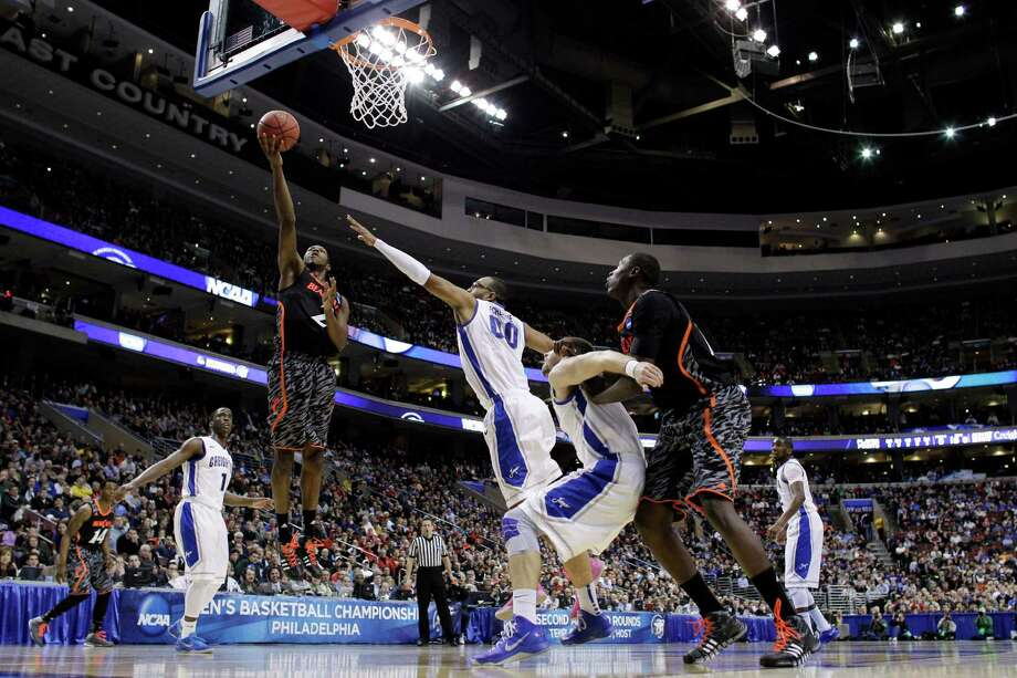 Cincinnati's Titus Rubles (2) goes up for a shot as Creighton's Gregory Echenique (00) defends during the first half of a second-round game of the NCAA college basketball tournament, Friday, March 22, 2013, in Philadelphia. (AP Photo/Matt Slocum) Photo: Matt Slocum, Associated Press / AP