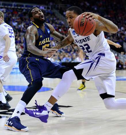 Kansas State Wildcats guard Rodney McGruder (22) fouls La Salle Explorers guard Ramon Galloway (55) during a second-round game in the NCAA Men's Basketball Tournament at the Sprint Center in Kansas City, Missouri, Friday, March 22, 2013. (John Sleezer/Kansas City Star/MCT) Photo: John Sleezer, McClatchy-Tribune News Service / Kansas City Star