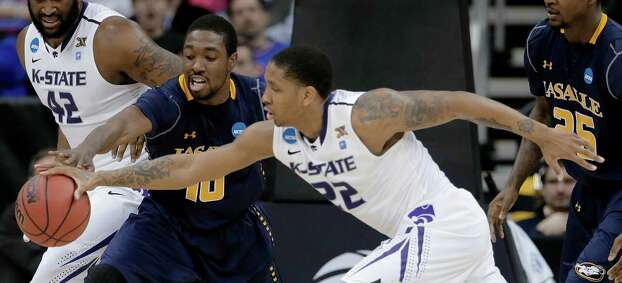 Kansas State guard Rodney McGruder (22) and La Salle guard Sam Mills (10) chase a loose ball during the first half of a second-round game of the NCAA men's college basketball tournament Friday, March 22, 2013, in Kansas City, Mo. (AP Photo/Charlie Riedel) Photo: Charlie Riedel, Associated Press / AP