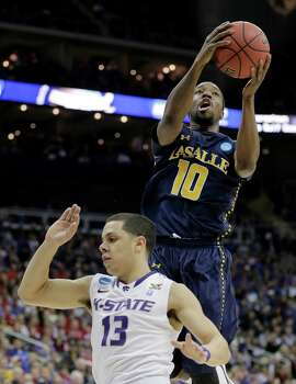 La Salle guard Sam Mills (10) puts up a shot over Kansas State guard Angel Rodriguez (13) during the first half of a second-round game of the NCAA college basketball tournament Friday, March 22, 2013, in Kansas City, Mo. (AP Photo/Charlie Riedel) Photo: Charlie Riedel, Associated Press / AP