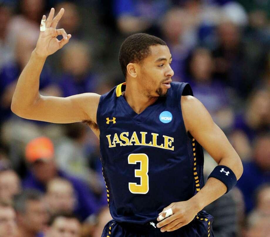 La Salle 63, Kansas State 61La Salle guard Tyreek Duren celebrates after a 3-point basket during the Explorers' stunning win in Kansas City, Mo. Photo: Orlin Wagner, Associated Press / AP