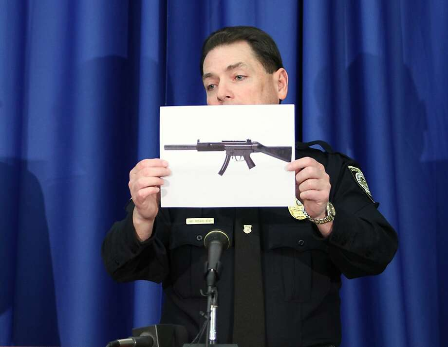 University of Central Florida Police Chief Richard Beary shows the type of gun found in the room of a UCF student during a press conference in Orlando, Florida, Monday, March 18, 2013. Police found a former male student dead from what appears to be a self-inflicted gunshot wound. Law enforcement officers investigating the incident found a handgun, an assault weapon and improvised explosive devices, a campus spokeswoman said. (Gary W. Green/Orlando Sentinel/MCT) Photo: Gary W. Green, McClatchy-Tribune News Service
