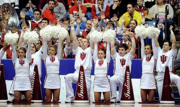 The Indiana Hoosiers cheerleaders sit on the baseline in the second half against the James Madison Dukes. Photo: Jason Miller, Getty Images / 2013 Getty Images
