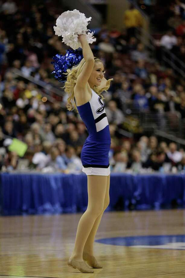 A Creighton Bluejays cheerleader performs on the court while the Bluejays take on the Cincinnati Bearcats. Photo: Rob Carr, Getty Images / 2013 Getty Images