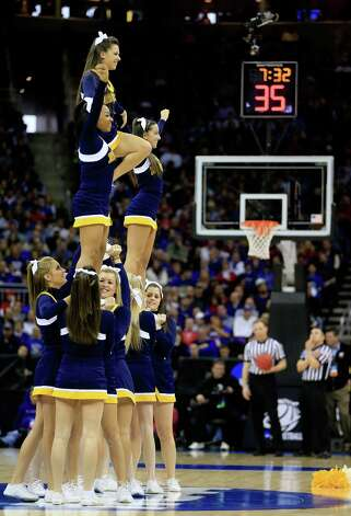 The La Salle Explorers cheerleaders perform in the second half against the Kansas State Wildcats. Photo: Jamie Squire, Getty Images / 2013 Getty Images