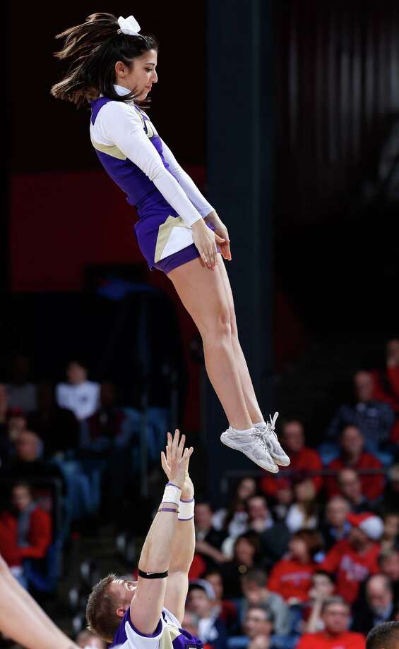 A James Madison Dukes cheerleader performs on the court during a game stoppage in the first half. Photo: Joe Robbins, Getty Images / 2013 Getty Images