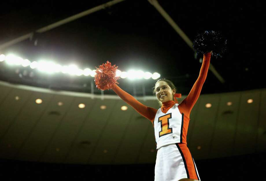 A cheerleader of the Illinois Fighting Illini performs before the start of the game against the Colorado Buffaloes during the second round. Photo: Ronald Martinez, Getty Images / 2013 Getty Images
