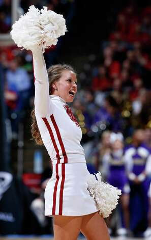 An Indiana Hoosiers cheerleader performs on the court during a game stoppage in the first half against the James Madison Dukes. Photo: Joe Robbins, Getty Images / 2013 Getty Images