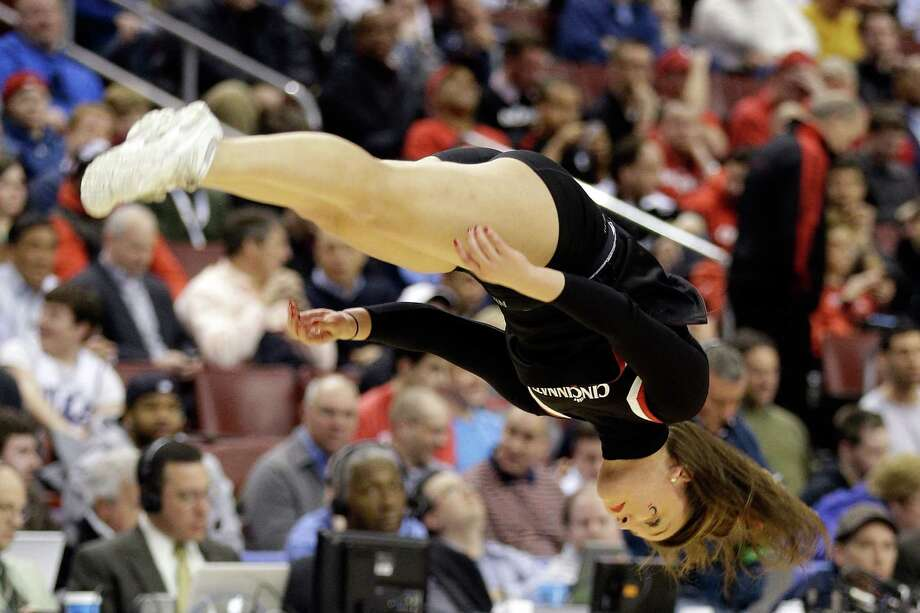A Cincinnati Bearcats cheerleader performs in the first half during a break in the game against the Creighton Bluejays during the second round. Photo: Rob Carr, Getty Images / 2013 Getty Images