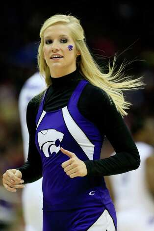 A Kansas State Wildcats cheerleader performs in the first half against the La Salle Explorers during the second round. Photo: Jamie Squire, Getty Images / 2013 Getty Images
