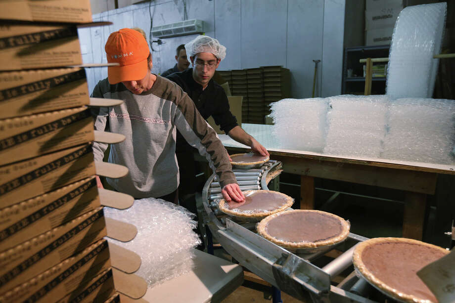 Front to back, production manager Marcia Chamberlain, distribution manager Ryan Mooney and IT department's Craig Smith package Heavenly Chocolate Pies for shipping at the Tootie Pie Company warehouse in Boerne, Wednesday, Feb. 27, 2013. Photo: Jerry Lara, San Antonio Express-News / © 2013 San Antonio Express-News