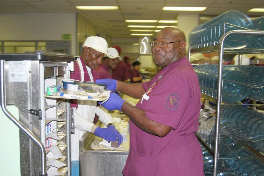 Many tasks go into hospital food service, including managing inventory, prepping items for recipes, prepping hot or cold food items, cooking and assembling food trays.