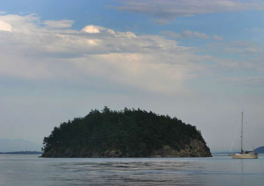 A small island is shown in a remote area of the most northern San edge of the San Juans. On Monday President Barack Obama will create a 955-acre national monument in the scenic San Juan Islands. We figured it was a time to show some photos from our state's treasure. (Joshua Trujillo, seattlepi.com)