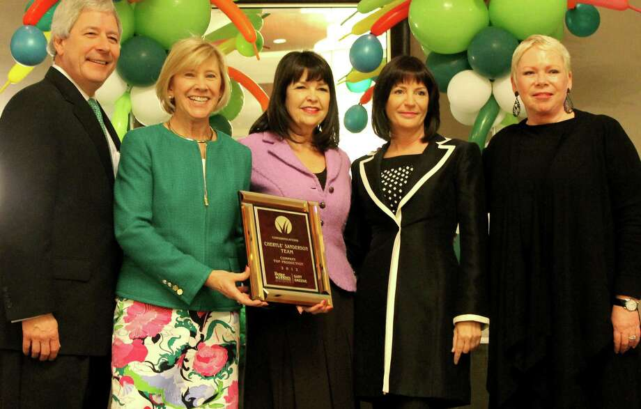 Better Homes and Gardens Real Estate Gary Greene honored its top-producing agents at its Awards Breakfast, March 11, at the Westin Memorial City. Pictured here (from left) are Mark Woodroof and Marilyn Eiland, partners with the company; Cherylé Sanderson and Cecelia Smith with the Cherylé Sanderson Team, receiving the Top Team Production Award; and Sherry Chris, president and CEO of Better Homes and Gardens Real Estate.