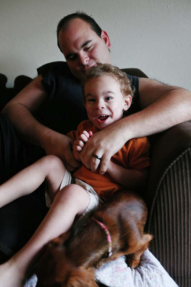 Texas State Prison guard Steve Milner plays with his son, Shaun, at their apartment in Bay City, Texas, Wednesday, March 6, 2013. Milner with his wife, Cayla and son moved from Karnes County due to the high rent driven by demands from the Eagle Ford Shale Play. Photo: JERRY LARA, San Antonio Express-News / © 2013 San Antonio Express-News