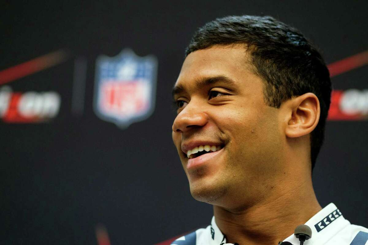 Russell Wilson answers media questions.