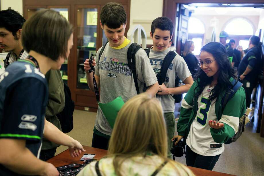 Students file into the library to meet Russell Wilson. Photo: JORDAN STEAD / SEATTLEPI.COM