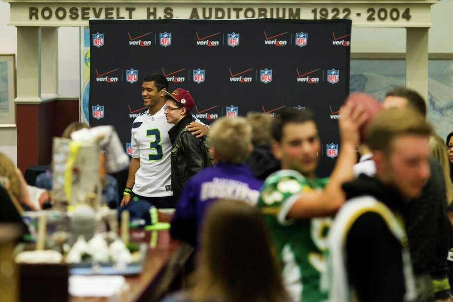 Russell Wilson greets student fans. Photo: JORDAN STEAD / SEATTLEPI.COM
