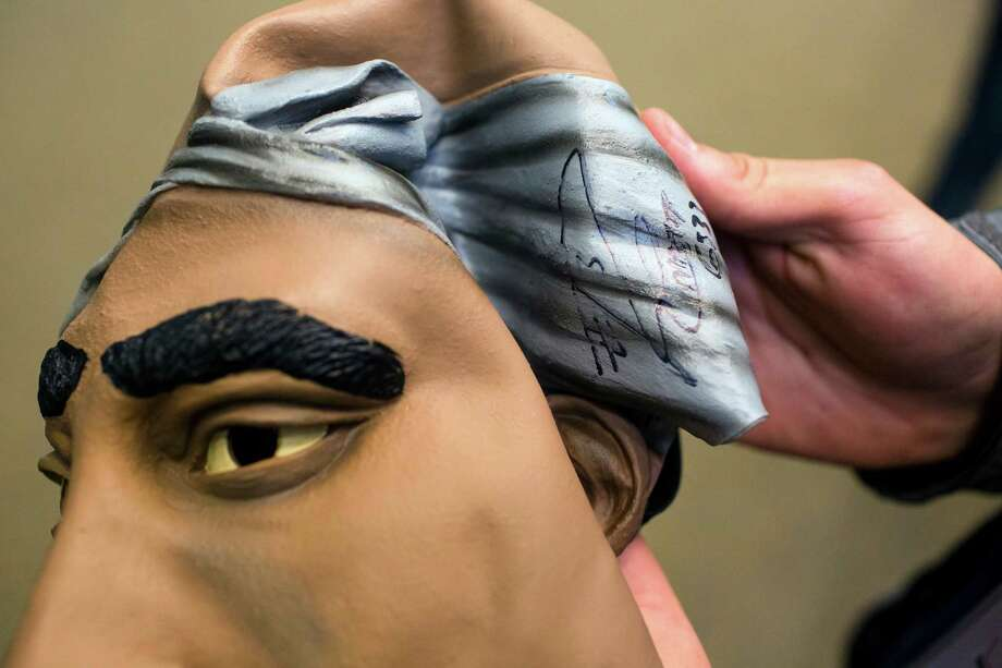 Student Hank Reimers shows off his Russell Wilson-signed Tupac mask. Photo: JORDAN STEAD / SEATTLEPI.COM