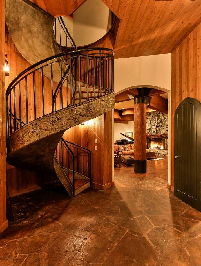 Main house staircase of Scimitar Ridge Ranch, 7535 Highway 20, on Fidalgo Island. The 70-acre camp, built in 1993, features a 21,760-square-foot main residence, a lodge, a chapel, a barn turned lodge known as 'The Ark,' a barn turned apartment, a chapel, a carriage house, a pump station, an office with two apartments and a barbecue pavilion. It's listed for $8.5 million. Photo: Courtesy John Prosser And Wally Gudgell/Windermere Real Estate