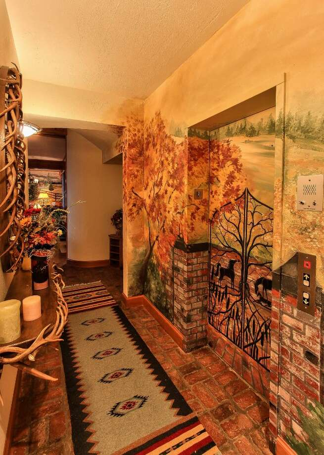 Main house elevator of Scimitar Ridge Ranch, 7535 Highway 20, on Fidalgo Island. The 70-acre camp, built in 1993, features a 21,760-square-foot main residence, a lodge, a chapel, a barn turned lodge known as 'The Ark,' a barn turned apartment, a chapel, a carriage house, a pump station, an office with two apartments and a barbecue pavilion. It's listed for $8.5 million. Photo: Courtesy John Prosser And Wally Gudgell/Windermere Real Estate