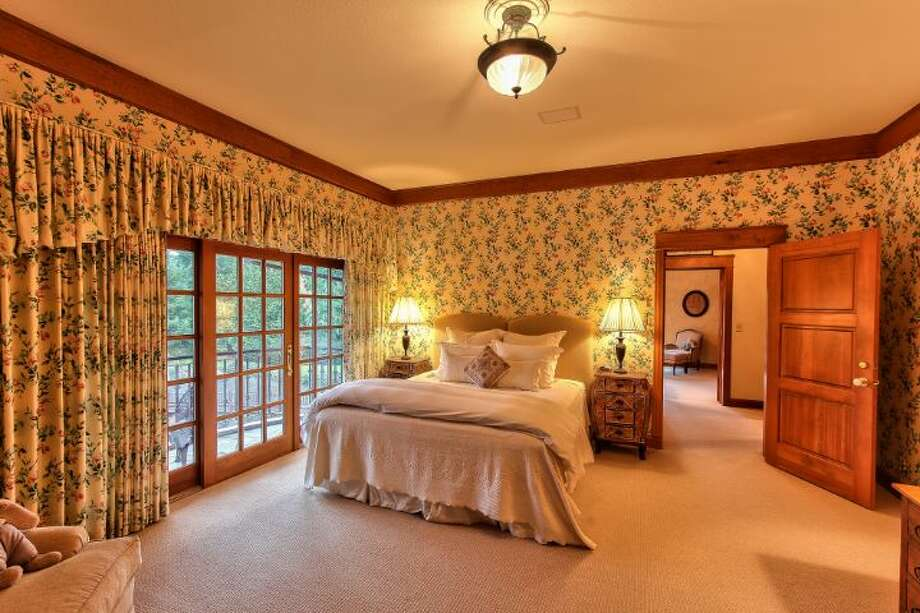 Main house bedroom of Scimitar Ridge Ranch, 7535 Highway 20, on Fidalgo Island. The 70-acre camp, built in 1993, features a 21,760-square-foot main residence, a lodge, a chapel, a barn turned lodge known as 'The Ark,' a barn turned apartment, a chapel, a carriage house, a pump station, an office with two apartments and a barbecue pavilion. It's listed for $8.5 million. Photo: Courtesy John Prosser And Wally Gudgell/Windermere Real Estate