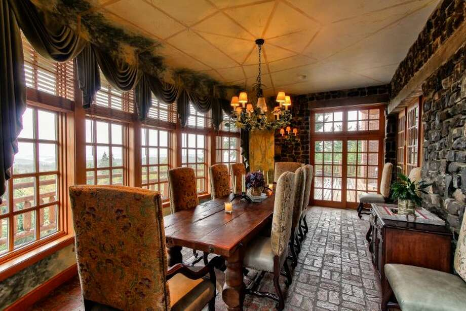 Main house dining room of Scimitar Ridge Ranch, 7535 Highway 20, on Fidalgo Island. The 70-acre camp, built in 1993, features a 21,760-square-foot main residence, a lodge, a chapel, a barn turned lodge known as 'The Ark,' a barn turned apartment, a chapel, a carriage house, a pump station, an office with two apartments and a barbecue pavilion. It's listed for $8.5 million. Photo: Courtesy John Prosser And Wally Gudgell/Windermere Real Estate