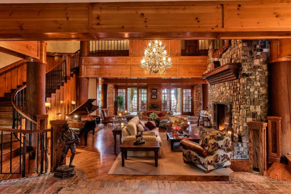 Main house entry and great room of Scimitar Ridge Ranch, 7535 Highway 20, on Fidalgo Island. The 70-acre camp, built in 1993, features a 21,760-square-foot main residence, a lodge, a chapel, a barn turned lodge known as 'The Ark,' a barn turned apartment, a chapel, a carriage house, a pump station, an office with two apartments and a barbecue pavilion. It's listed for $8.5 million.