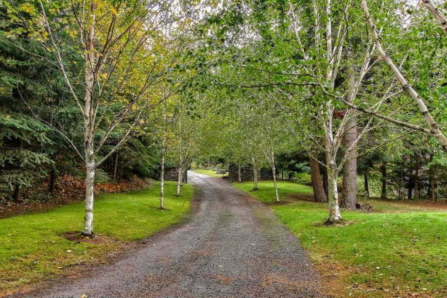 Driveway of Scimitar Ridge Ranch, 7535 Highway 20, on Fidalgo Island. The 70-acre camp, built in 1993, features a 21,760-square-foot main residence, a lodge, a chapel, a barn turned lodge known as 'The Ark,' a barn turned apartment, a chapel, a carriage house, a pump station, an office with two apartments and a barbecue pavilion. It's listed for $8.5 million. Photo: Courtesy John Prosser And Wally Gudgell/Windermere Real Estate