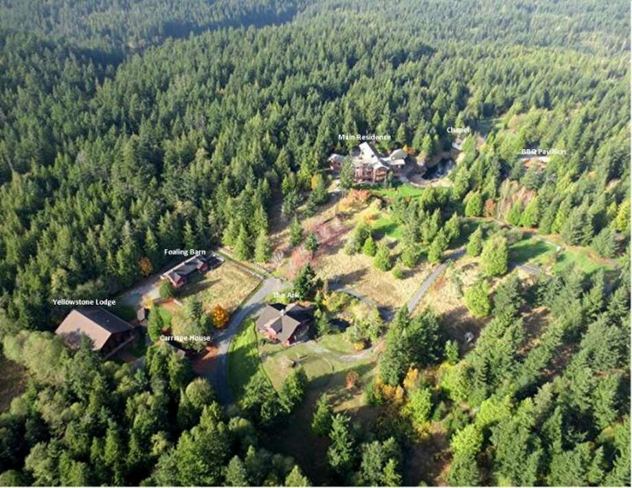 Aerial view of Scimitar Ridge Ranch, 7535 Highway 20, on Fidalgo Island. The 70-acre camp, built in 1993, features a 21,760-square-foot main residence, a lodge, a chapel, a barn turned lodge known as 'The Ark,' a barn turned apartment, a chapel, a carriage house, a pump station, an office with two apartments and a barbecue pavilion. It's listed for $8.5 million. Photo: Courtesy John Prosser And Wally Gudgell/Windermere Real Estate