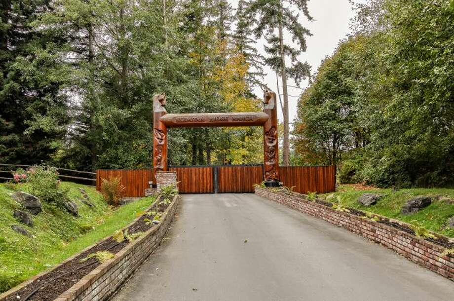 Gate of Scimitar Ridge Ranch, 7535 Highway 20, on Fidalgo Island. The 70-acre camp, built in 1993, features a 21,760-square-foot main residence, a lodge, a chapel, a barn turned lodge known as 'The Ark,' a barn turned apartment, a chapel, a carriage house, a pump station, an office with two apartments and a barbecue pavilion. It's listed for $8.5 million. Photo: Courtesy John Prosser And Wally Gudgell/Windermere Real Estate