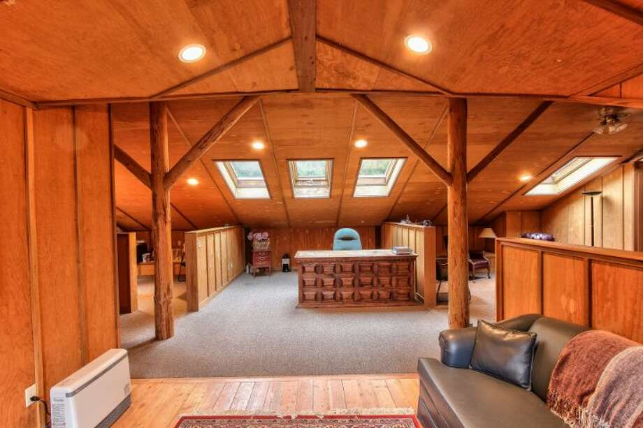 Office of Scimitar Ridge Ranch, 7535 Highway 20, on Fidalgo Island. The 70-acre camp, built in 1993, features a 21,760-square-foot main residence, a lodge, a chapel, a barn turned lodge known as 'The Ark,' a barn turned apartment, a chapel, a carriage house, a pump station and a barbecue pavilion. It's listed for $8.5 million. Photo: Courtesy John Prosser And Wally Gudgell/Windermere Real Estate