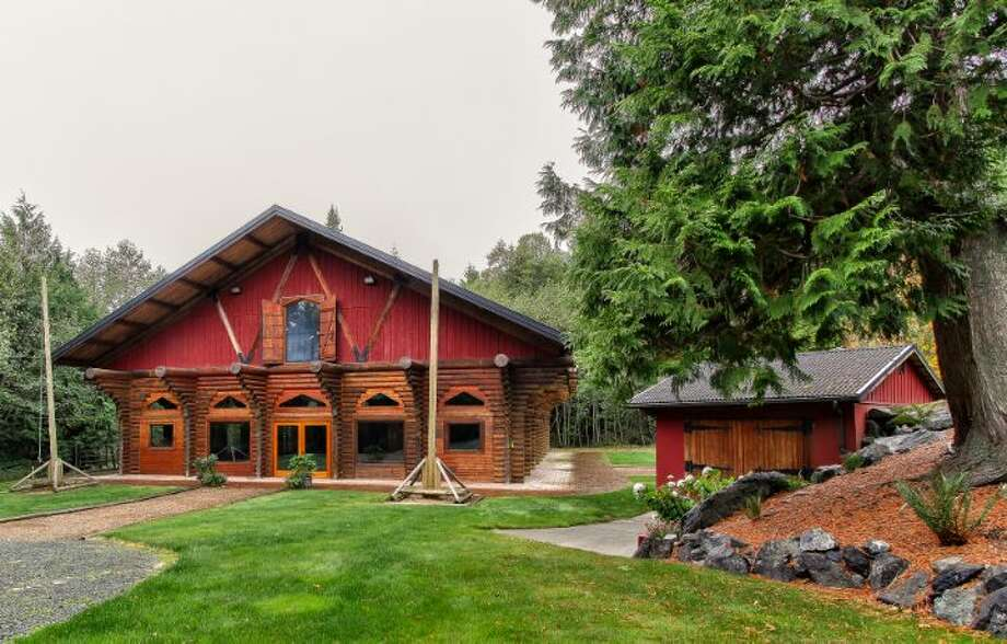Lodge of Scimitar Ridge Ranch, 7535 Highway 20, on Fidalgo Island. The 70-acre camp, built in 1993, features a 21,760-square-foot main residence, a chapel, a barn turned lodge known as 'The Ark,' a barn turned apartment, a chapel, a carriage house, a pump station, an office with two apartments and a barbecue pavilion. It's listed for $8.5 million. Photo: Courtesy John Prosser And Wally Gudgell/Windermere Real Estate