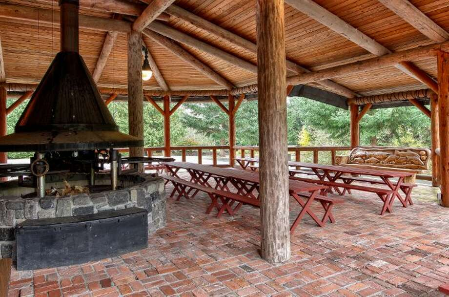 Barbecue pavilion of Scimitar Ridge Ranch, 7535 Highway 20, on Fidalgo Island. The 70-acre camp, built in 1993, features a 21,760-square-foot main residence, a lodge, a chapel, a barn turned lodge known as 'The Ark,' a chapel, a carriage house, a pump station, an office with two apartments and a barn turned apartment. It's listed for $8.5 million. Photo: Courtesy John Prosser And Wally Gudgell/Windermere Real Estate