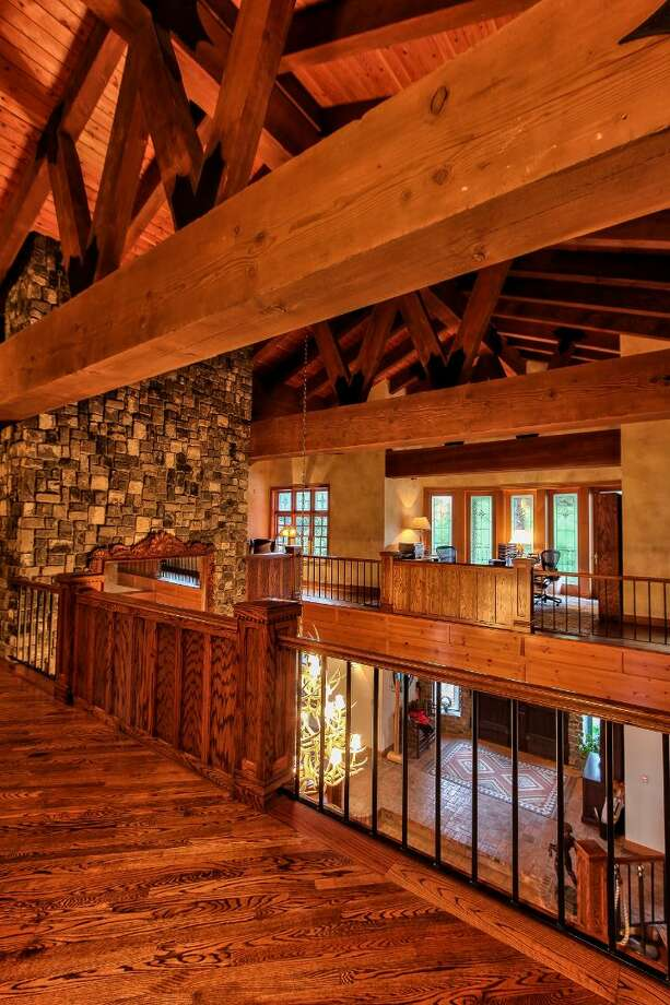 Main house upper level hallway of Scimitar Ridge Ranch, 7535 Highway 20, on Fidalgo Island. The 70-acre camp, built in 1993, features a 21,760-square-foot main residence, a lodge, a chapel, a barn turned lodge known as 'The Ark,' a barn turned apartment, a chapel, a carriage house, a pump station, an office with two apartments and a barbecue pavilion. It's listed for $8.5 million. Photo: Courtesy John Prosser And Wally Gudgell/Windermere Real Estate