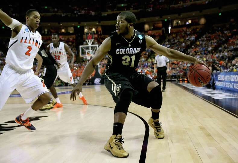 Jeremy Adams #31 of the Colorado Buffaloes controls the ball away from Joseph Bertrand #2 of the Ill