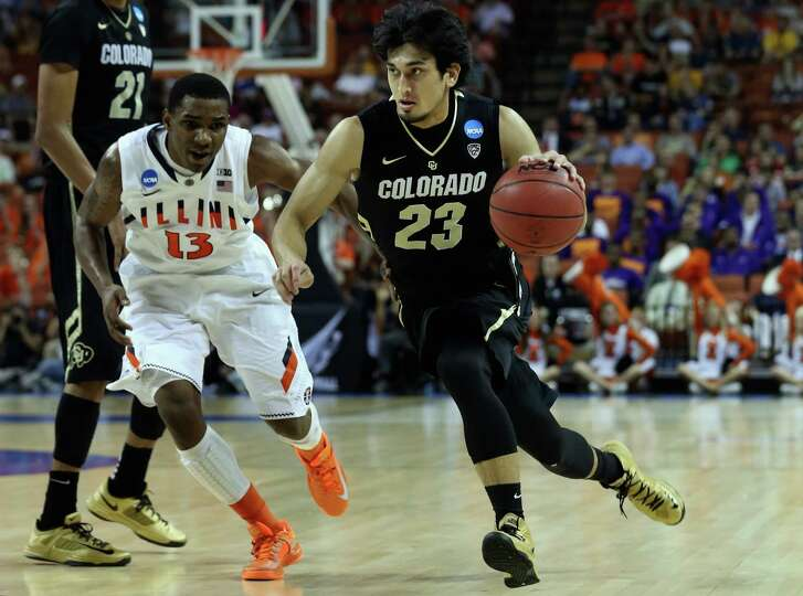 Sabatino Chen #23 of the Colorado Buffaloes dribbles past Tracy Abrams #13 of the Illinois Fighting