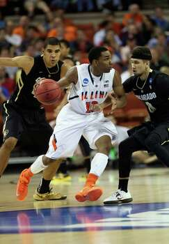 Tracy Abrams #13 of the Illinois Fighting Illini dribbles past Askia Booker #0 of the Colorado Buffaloes. Photo: Stephen Dunn, Getty Images / 2013 Getty Images
