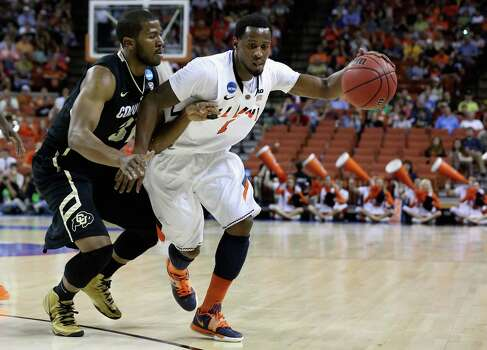 D.J. Richardson #1 of the Illinois Fighting Illini dribbles past Jeremy Adams #31 of the Colorado Buffaloes during the second round. Photo: Stephen Dunn, Getty Images / 2013 Getty Images