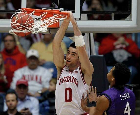Indiana 83, James Madison 62Indiana's Will Sheehey (0) dunks against James Madison's Charles Cooke (4) in the second half in the second round of the NCAA Tournament at the University of Dayton Arena in Dayton, Ohio, on Friday, March 22, 2013. Indiana won, 83-62. (Brian Cassella/Chicago Tribune/MCT) Photo: Brian Cassella, McClatchy-Tribune News Service / Chicago Tribune