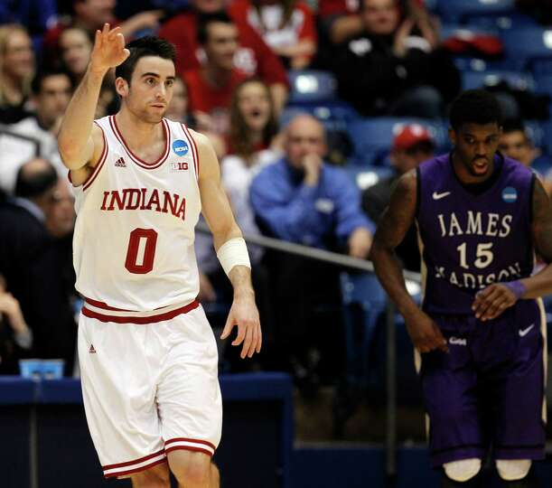 Indiana's Will Sheehey (0) celebrates a 3-pointer against James Madison's Andre Nation (15) in the s